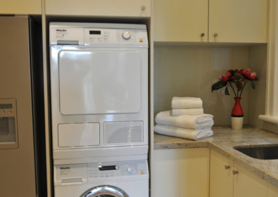 MAIN-laundry-laminate-glass-splashback-granite-benchtop-undermount-sink-washer-dryer-stack-refridgerator-kitchen-pdate