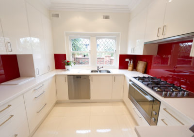 MAIN-two-pack-painted-dulux-vivid-white-gloss-red-box-glass-splashback-corian-antartica-kitchen-update