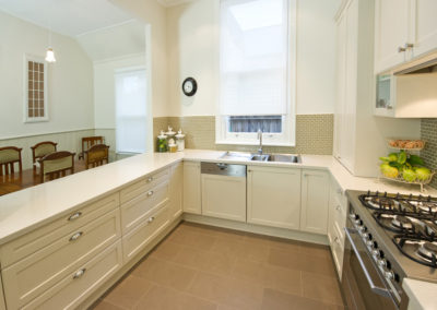 MAIN-two-pack-painted-shaker-hog-bristle-traditional-corian-savannah-small-glass-tile-splashback-kitchen-update
