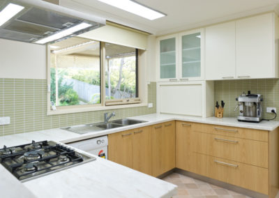 MAIN-white-timber-laminate-corian-witch-hazel-benchtops-matrix-tile-splashback-frosted-glass-cabinets-roller-shutter-appliance-kitchen-update-3