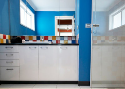 bathroom-bright-blue-red-yellow-primary-colours-black-white-tiles-laminate-vanity-kitchen-update-2