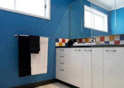bathroom-bright-blue-red-yellow-primary-colours-black-white-tiles-laminate-vanity-kitchen-update