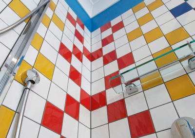bathroom-primary-colours-tiles-shower-red-yellow-blue-white-mixer-kitchen-update