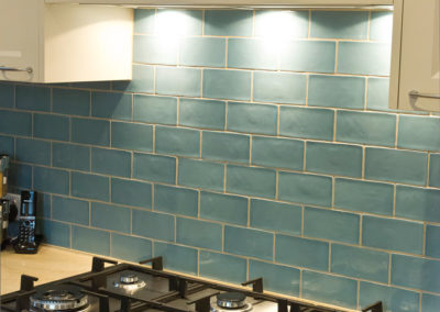 beige-shaker-blue-subway-tile-corian-tumbleweed-gas-cooktop-kitchen-update