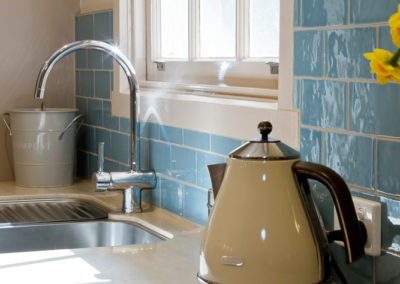 blue-subway-tile-corian-tumbleweed-undermount-sink-kettle-kitchen-update
