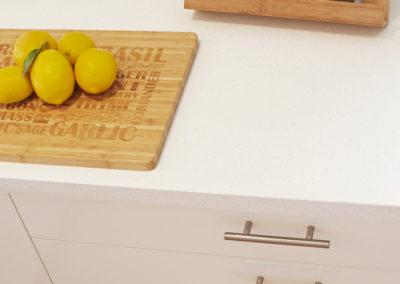 laminex-polar-white-silk-caesarstone-ocean-foam-glass-splashback-drawers-handles-stainless-steel-lemons-chopping-board-kitchen-update