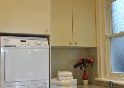 laundry-laminate-glass-splashback-granite-benchtop-undermount-sink-washer-dryer-stack-kitchen-pdate