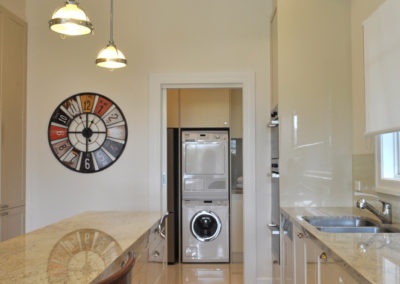 laundry-washer-dryer-stack-sliding-doorway-kitchen-update