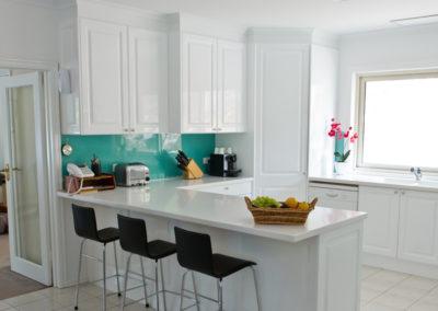 polytec-white-gloss-argentina-aqua-rockpool-glass-splashback-corner-pantry-bar-stools-corian-kitchen-update-3
