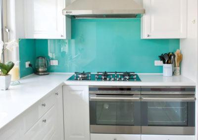 polytec-white-gloss-argentina-aqua-rockpool-glass-splashback-electrolux-double-ovens-qasair-canopy-rangehood-corian-kitchen-update