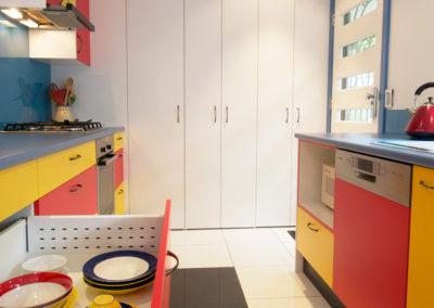 primary-colours-red-yellow-blue-white-black-laminate-glass-splashback-crockery-drawer-blum-kitchen-update