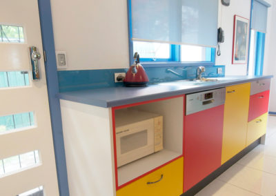 primary-colours-red-yellow-blue-white-black-laminate-glass-splashback-underbench-microwave-integrated-dishwasher-kitchen-update
