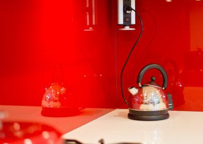 red-glass-splashback-EVOline-pull-down-kitchen-update