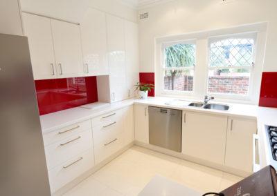 two-pack-painted-dulux-vivid-white-gloss-red-box-glass-splashback-bi-fold-appliance-cabinet-kitchen-update