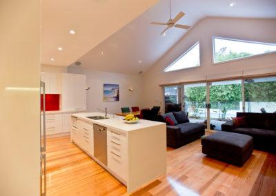 white-gloss-casarstone-island-bench-triangle-windows-kitchen-update