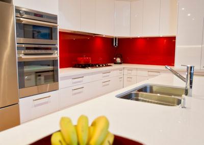 white-gloss-red-glass-splashback-casaerstone-undermount-sink-kitchen-update