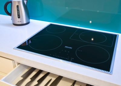 white-gloss-two-pack-caesarstone-turquoise-blue-green-glass-splashback-miele-induction-cooktop-blum-drawer-kitchen-update
